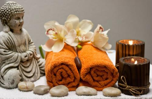 Buddha figure with rolled towels